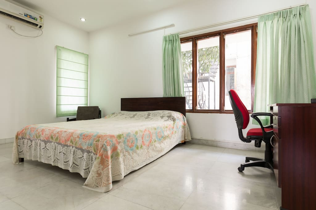 Master Bed room with a table and chair