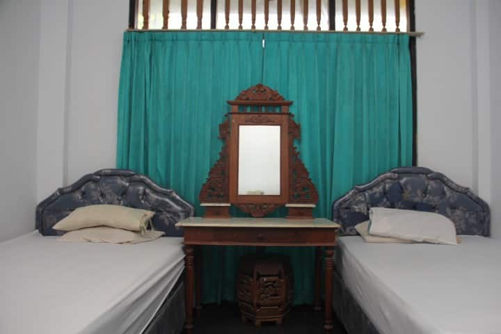 Simple Room at Balinese House in Denpasar #1
