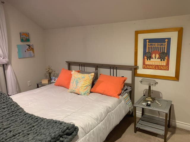 Large bedroom  with a queen size bed, large closet, is in the second floor.