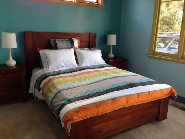 Queen size bed. Feather and down doona cover (duvet cover).  Bedside tables with lamps & three drawers. Electric blanket.  Four different pillows for you to choose from.