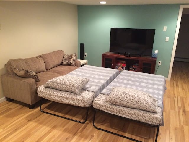 Two twin cots can easily be set up in the living room by request.
