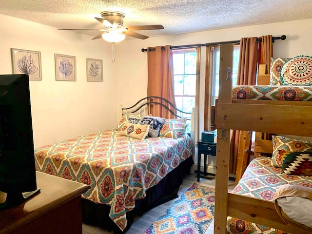 Bedroom One:  Queen Bed, Bunk with two full-size twins, Bureau, TV and Closet
