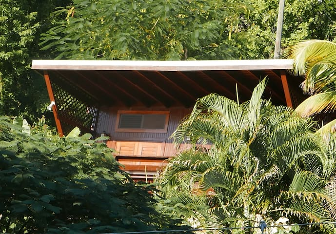 Viewing the Treehouse Hideaway Villa II from the back as it faces the Pitons and ocean.