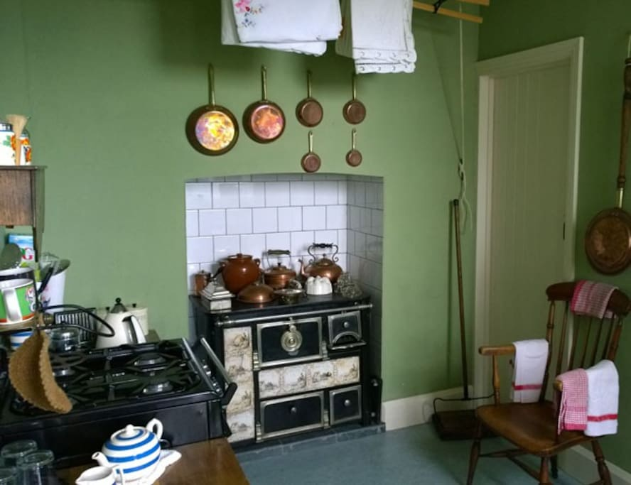 The kitchen has a scullery and a larder. There is also a modern gas oven