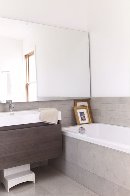 Bright, luxurious 4 piece washroom with deep and long soaker tub