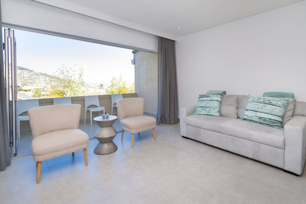 Spacious lounge opens up onto balcony with views of Lion's Head.