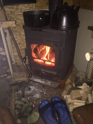 Wood burning stove in Coed Obry A-Frame Bunkhouse