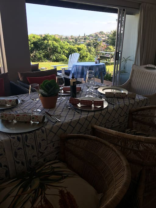 A dining room over looking the garden and sea.