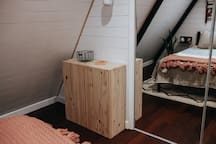 Modern pine cabinet to store your belongings while in the cabin.