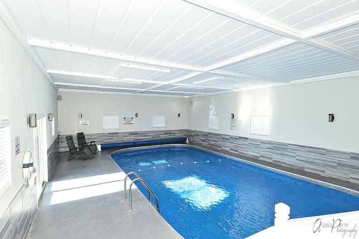 Huge indoor inground pool and theater in house