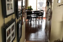 Peering from living room into dining room to the outside deck