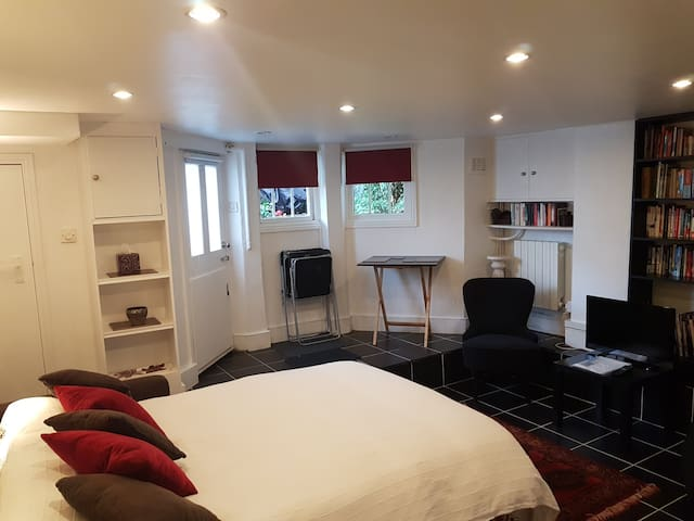 Bed and living space, showing own front door
