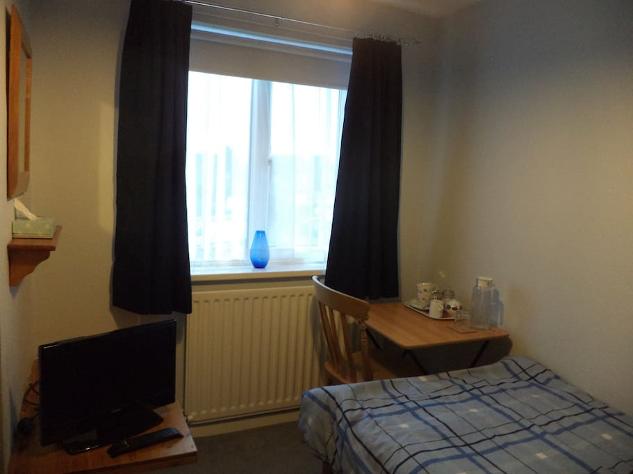 Blackout blind and curtains, TV, writing desk plus tea making facilities