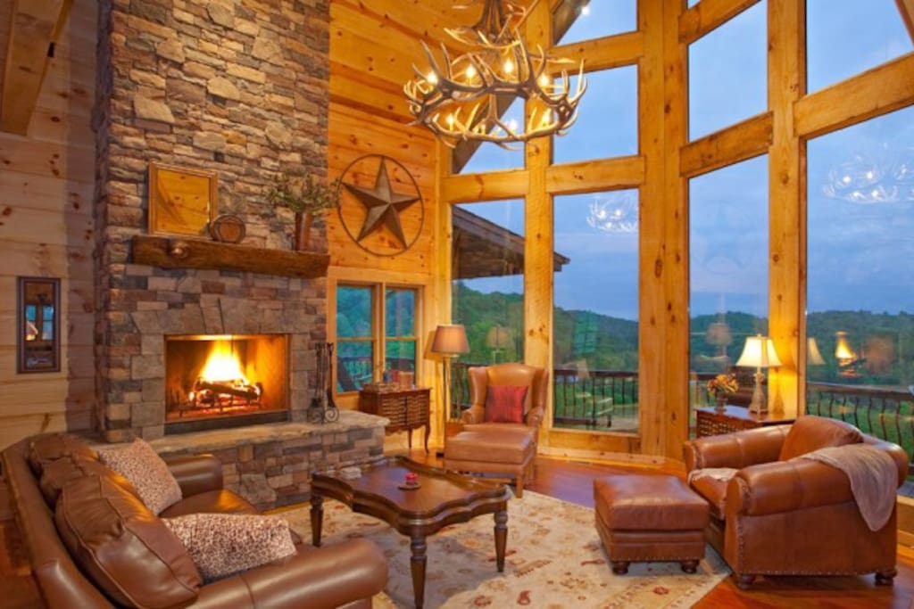 Living Room featuring Stunning Window Wall & Large Stone Wood-burning Fireplace