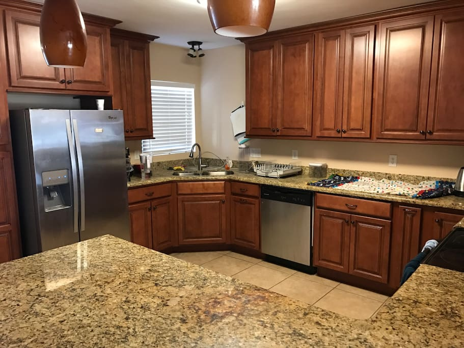 Full kitchen with fridge and dishwasher