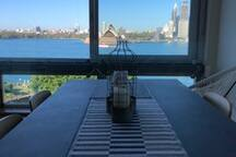 Dining room table 6 seater with views to Sydney Harbour.  Who needs to go out for dinner with a view like this.