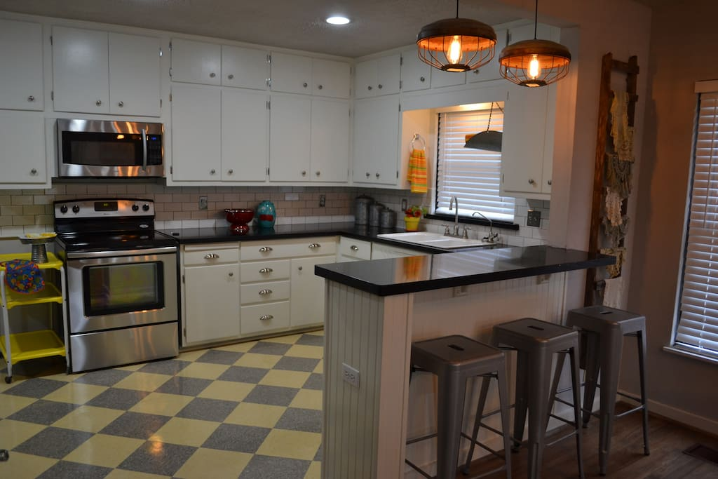 """Kitchen-Custom 40's floor,""""sparkle"""" countertops,  loaded stainless w/dishwasher"""