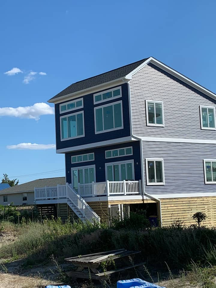 Newly built Sandcastle directly ON the beach