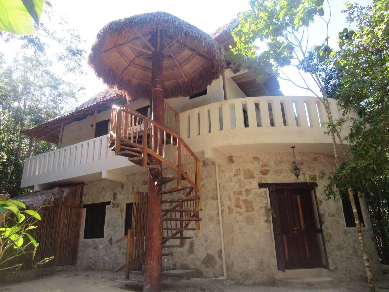 The entrance to the accommodation, which is the whole second floor on top of  the stone house, is spiral staircase.