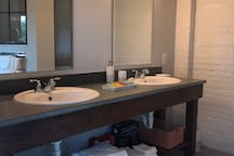 Bathroom with concrete double sink vanity