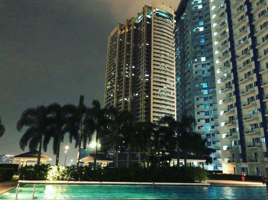 night view of adult pool
