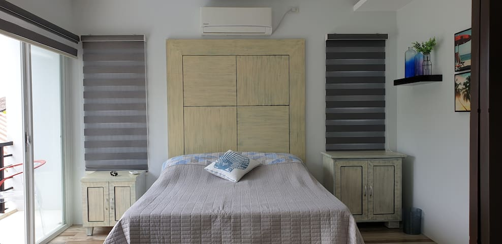 This is one of the 2 adjoining rooms that face the ocean. If you live in the city where you rarely smell the scent of a flower, look out to the distant horizon or listen to the sound of the sea, you may forget that you ever loved these pleasures.