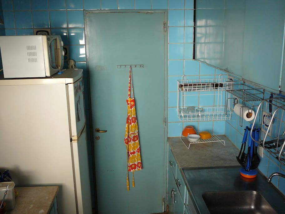 Kitchen with fridge, freezer, microwave, stove and oven.