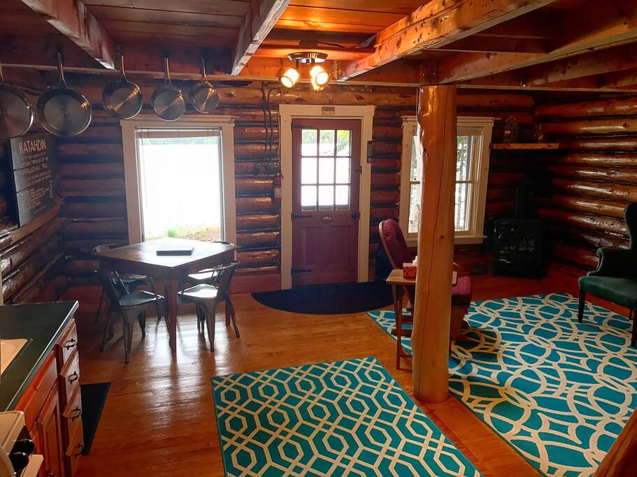 "The ""main"" cabin, 125+ year old log construction from the heyday of Rangeley sporting camps.  A full bathroom, entry, and master bedroom have been added to make it rustic but with normal amenities."