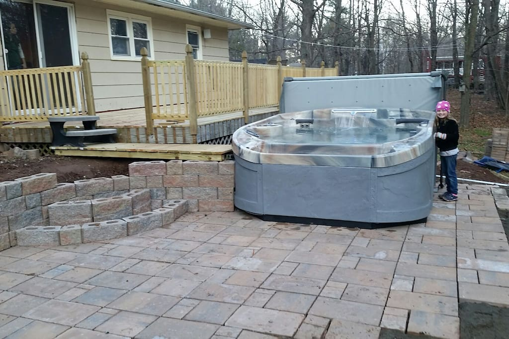 Brand new Hottub and patio. Patio is still under construction and may not be completely finished till next year