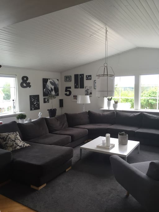 The living room with a large couch