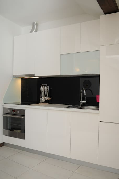 Kitchen including dishwasher.