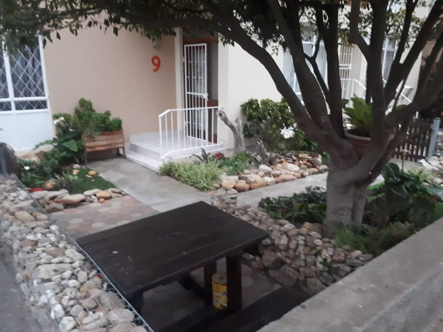 Fish pond at front entrance. Garden table with attached benches