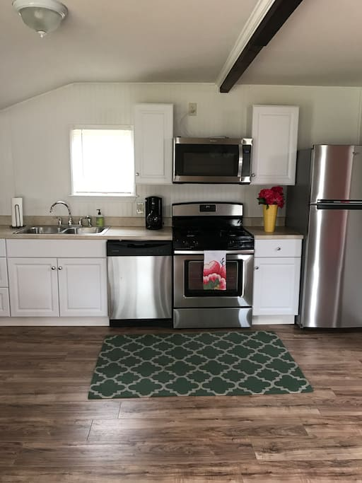 Full, newly renovated kitchen with dishwasher, stove, oven, microwave, fridge and freezer!  Well stocked with kitchen equipment and a coffee maker - let us know if you need anything additional for your culinary creations!