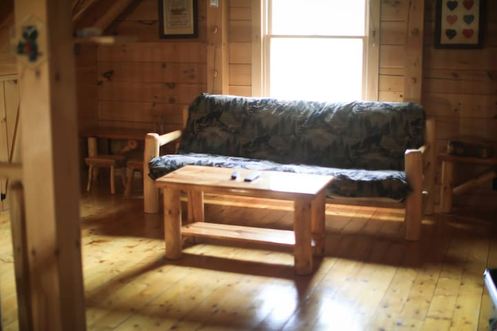 Full-sized futon in the cabin's loft which is accessed by a stairway.
