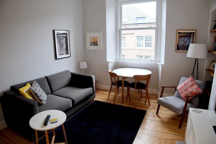 Top floor flat in convenient location