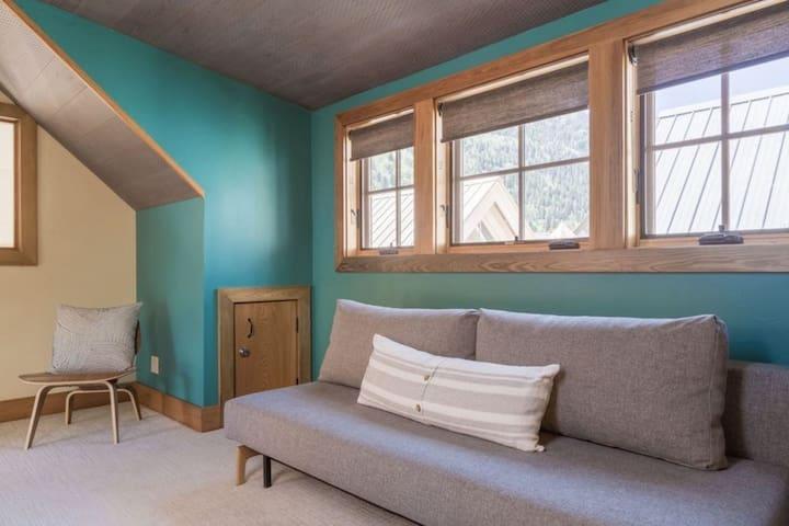op floor loft area with futon - cozy hangout with skylight and wine fridge
