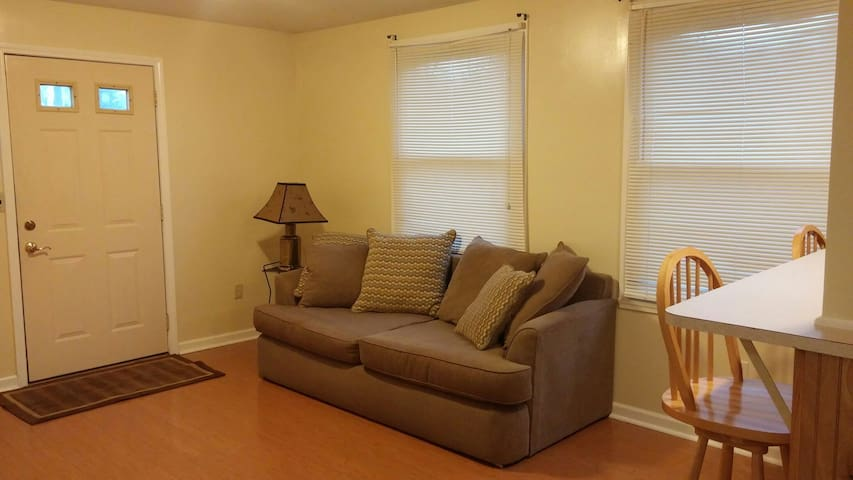 Shared use living room with sofa, coffee table and Cable TV.