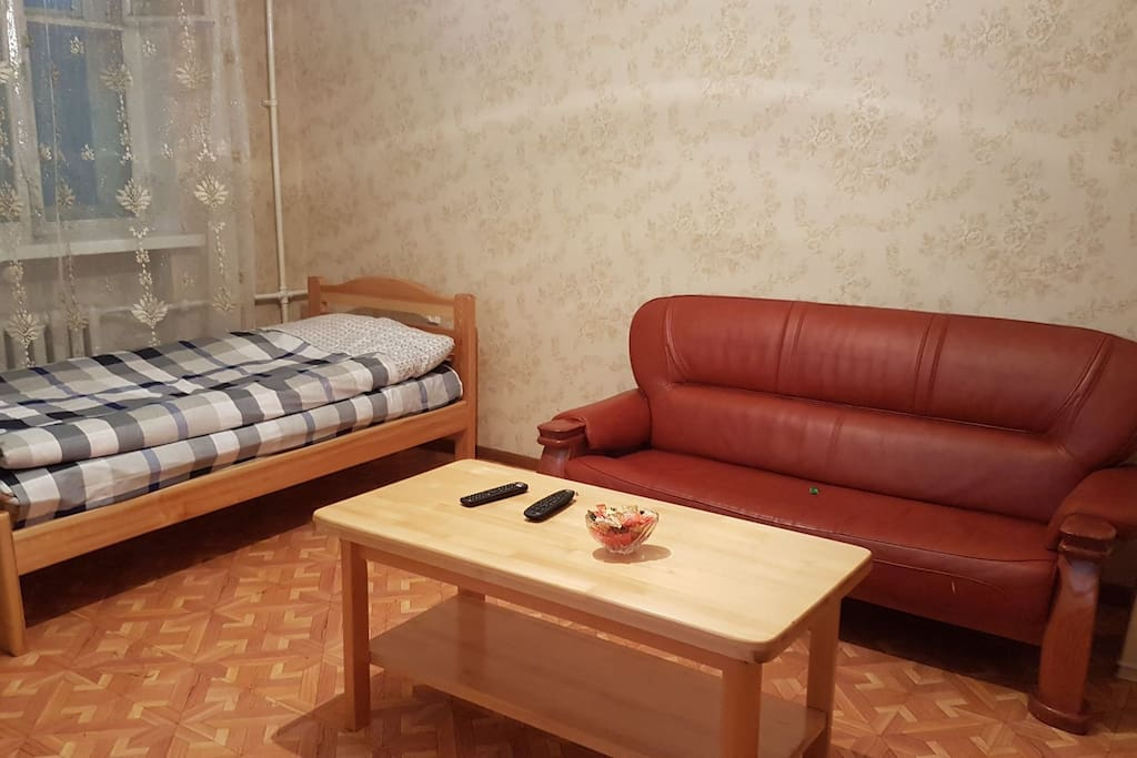 living room with another single bed confy sofa