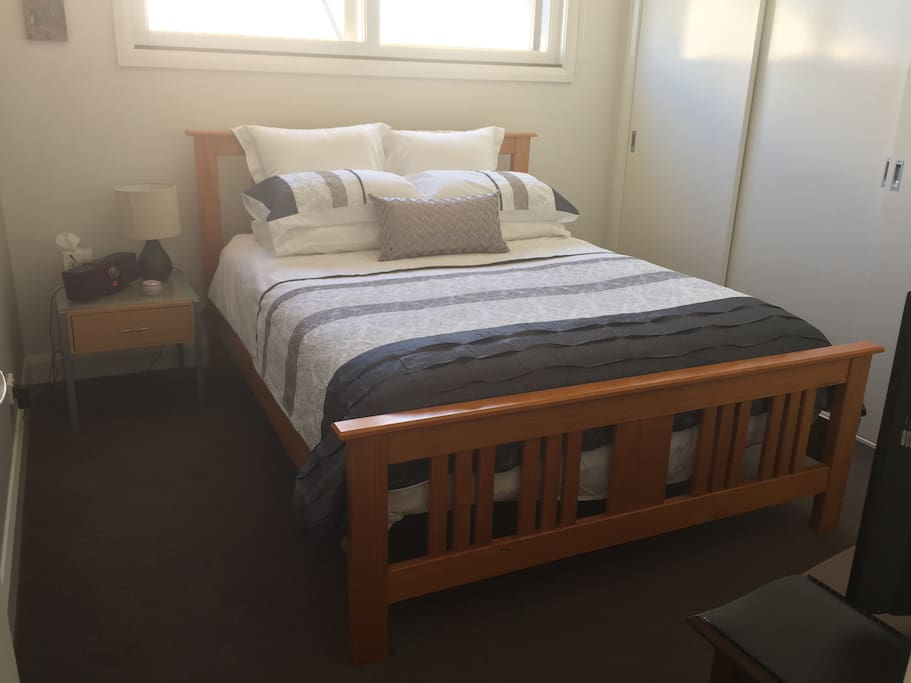 A super comfortable queen size bed in the main room.