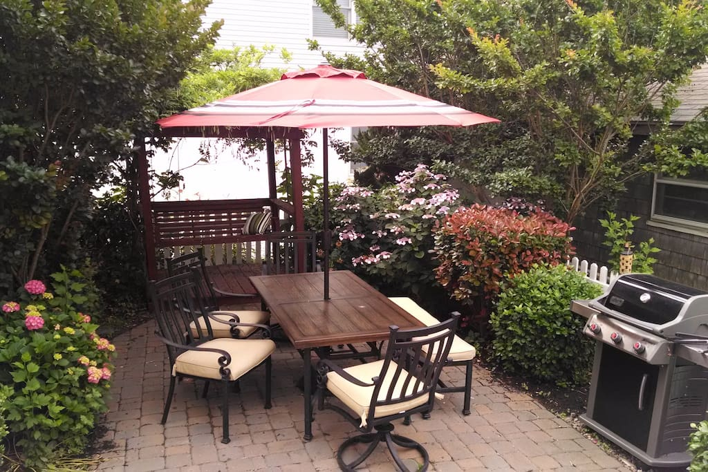 Several outdoor areas, including this grill &chill spot