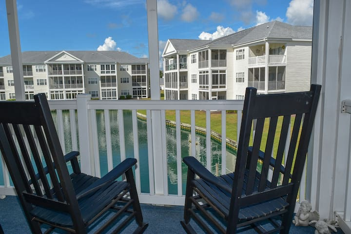 Beautiful condo with scenic views in Intracoastal waterway community. 2 bedroom/2 bath. Sleeps 6. Walk-up. 2nd floor. Screened porch.  1.2 miles from the beach. Great location! Outdoor pool with hot tubs. No smoking, no pets, no motorcycles.