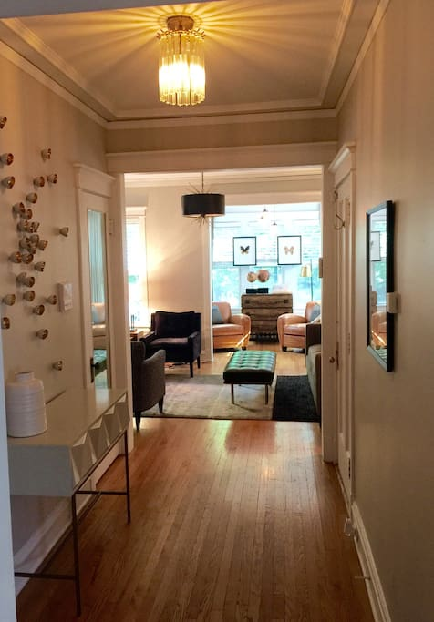 This is a look from the entry / foyer into the living room & front sunroom. We  finished the unit with no detail ignored or forgotten to provide a home away from home experience . Read all of our reviews and you will see what I'm talking about ... We do it all for you and your guests .