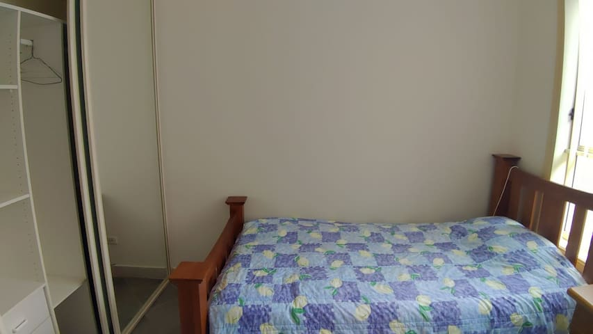 Bedroom  you have single size bed, closet with mirror, desk