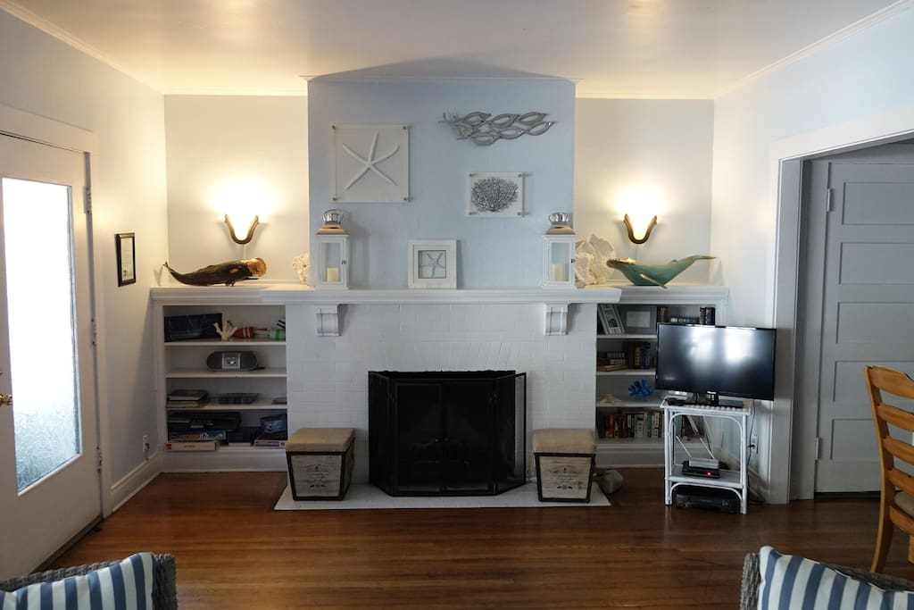 Gas fireplace, games, books, and nautical decor.