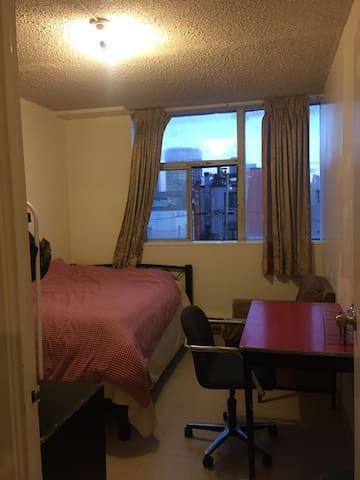 Core downtown room, second floor, big window