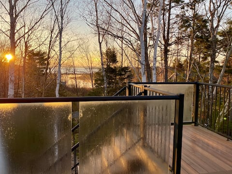 Cozy guest suite with large deck & water views