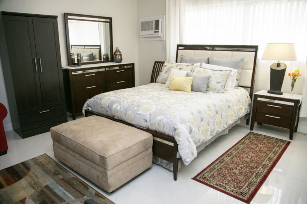Big suite with queen bed, queen-sized convertible sofa bed, and single roll-away bed (upon request.) Dresser, armoire and ottoman with fresh towels. Free parking. Free WI-FI internet connection. Free cable on TV.