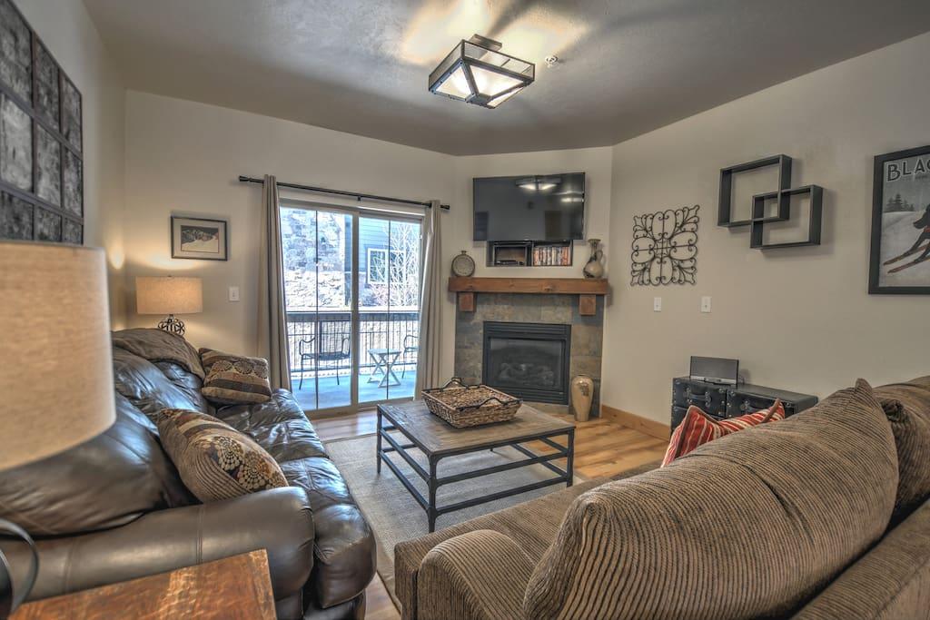 "Living Room - Gas Fireplace, sleeper sofa, 49"" HD Smart TV, DVD player, Bose Sound Docking Station, balcony access"