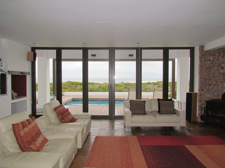 Large patio doors allow nearly uninterrupted view over the nature reserve and Atlantic ocean