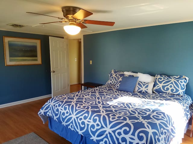 Roomy bedroom upstairs with a comfortable California king bed and closet space